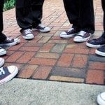 Shoes of groomsmen in circle on brick walk way at wedding ceremony in Nashville Tennessee
