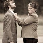Mother pins flower to groom at wedding ceremony in Nashville Tennessee