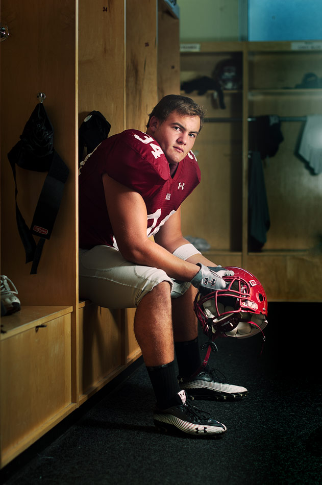 Locker room senior portrait of a football player in Nashville TN