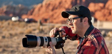 man with big camera in nevada redrocks
